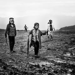 Mud...the final frontier (Frank Busch) Tags: frankbusch frankbuschphotography imagebyfrankbusch photobyfrankbusch bw blackwhite blackandwhite bnw field girls india mon mud nagaland rain tribes