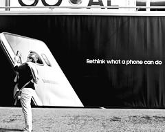 What a Phone can do (floressas.desesseintes) Tags: berlin berlinmitte unterdenlinden reklame advertising plakat poster phone smartphone handy mobile kamera camera samsung touristen tourists streetfotografie schwarzweis