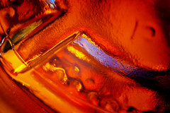 To the bottom of every bottle (jimj0will) Tags: mm macromonday bottom upsidedown base reds orange rusty colour color glass molded moulded pressed shaped transparent toffeevodka macro closeup tubes supertakumarlens supertakumar supertakpentaxlens manual bottomsup abstract