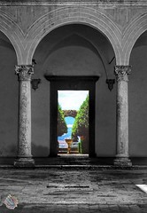 A world out there (fontanini.stefano) Tags: contrast sight light view canon travel italy pienza tuscany color bnw blackandwhite marble stone column arch old door