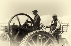 The good old days of steam........ (David Feuerhelm) Tags: momchrome sepia nikkor people men old movement tractionengine metal wheel atmosphere outdoor horseheath cambridgeshire silverefex nikon d750