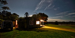 The cottage under the stars (geemuses) Tags: akolele bermagui southcoastnsw nsw newsouthwales night stars water light beautifullight longexposure canon scenic landscape travel color colour tree nature sky green blue beam cloud grass home cottage trees
