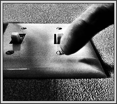 Light and Dark (Bob R.L. Evans) Tags: blackandwhite finger unusual lightswitch electricity abstract ipadphotography lightandshadow contrast