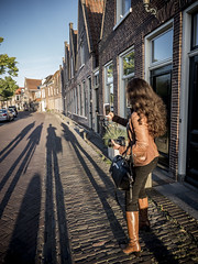 Deb, Alkmaar 2017: Catching the shadows (mdiepraam) Tags: alkmaar 2017 street houses shadow deb pretty beautiful brunette woman girl leatherjacket boots architecture building cityscape