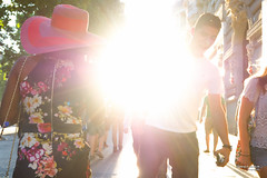 Street - Here comes the sun, la la la la (François Escriva) Tags: street streetphotography paris france olympus omd candid sun light rays sky woman man colors photo rue dress hat tshirt yellow orange pink red black white trees green buildings