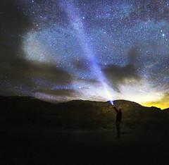 Enlightened (Robyn Hooz) Tags: light star death deathvalley stars stelle luce torcia pila self potrait ritratto buio nuvole raggio ray california