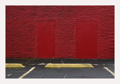 doors, red. (R. Drozda) Tags: portland oregon parking parkinglot pavementpaint parkingstop wall brick red paint door pdx drozda
