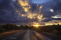 Stormy Sunset (Jacqui Barker Photography) Tags: flindersranges southaustralia southaustraliaoutback australia australiaoutback sunset storm road sunflare clouds stormclouds