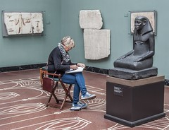 a quiet corner (seligr) Tags: denmark copenhagen museum glyptoteket sketching sketchpad statue egyptian flooring tiles seated hieroglyphics handbag