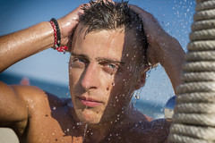 distracted. (After Mornin) Tags: beach boy blue eyes bulgaria irakli shower 5018 nikon d3100 sample