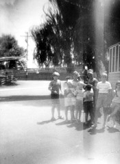 Cheap Bazooka Bubble Gum camera double exposure of my Los Angles Aunt & cousins, Mom, some friends, my sister standing on Rock Street AND dad's 1965 Pontiac Bonneville in the same frame. Light leaks galore! Milford Connecticut. July 1972 (wavz13) Tags: cheapcameras toycameras junkcameras junkycameras babettecameras cheapcamera toycamera junkcamera junkycamera babettecamera lomo lomography lomophotos lomophotographs lomopictures oldphotographs oldphotos 1970sphotographs 1970sphotos oldphotography 1970sphotography vintagesnapshots oldsnapshots vintagephotographs vintagephotos vintagephotography filmphotos filmphotography family familyphotos familyphotography oldfamilyphotos oldfamilyphotography vintagefamilyphotos vintagefamilyphotography vintagenewengland oldnewengland 1970snewengland vintagenewenglandphotography oldnewenglandphotography vintagemilford oldmilford 1970smilford vintagewoodmont oldwoodmont 1970swoodmont vintagekids vintageteens vintageteenagers teenmemories teenagememories vintageclothes oldclothes vintageclothing oldclothing vintagecars vintagecar oldcar oldcars 1960scars 127film rollfilm