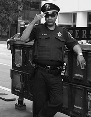 """Cool Copper"" - Downtown Chicago - 09 Jul 2017 - 7D II - 142 copy (Andre's Street Photography) Tags: downtownchicago09jul20177dii police officer copper metra masstransit federal lawenforcement candid photo chcago downtown loop innercity streets chicagostreets randolph michiganavenue randolphmichigan illinois uniform belt holster dutyweapon clips taser hat uniformhat salute right hand street straat straatportret streetportrait straatfotografie streetphotography fotografiadistrada bwphotography bw blackandwhite blancoynegro noiretblanc zwartwit schwarzweiss people city urban urbanlife streetlife coolcopper attitude persona publicrelations posture leaning relaxed photobyandrevanvegten chicagoist chicagoistphotos dedicatedtodianearbus tributetoedvanderelsken robertfranksworld vivianmaierstyle streetphotographyforum streetphotographymagazine dutchstreetphotographer enjoyillinois aroundillinois dedeka chicagojournal chicagoreader chicagotribune chicaomagazine"