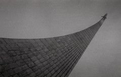 Monument to the Conquerors of Space (Andrew Sigurow) Tags: abstract analogue architecture bw building buildings cloud clouds film films geometry grain light lights line lines monument monuments outdoors outside sculpture sculptures shadow shadows skies sky ussr yashica moskva moscow russia ru