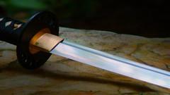 Sharp (Astral Eye) Tags: nature naturel extérieur eau rivière pierre caillou rocher lame épée artificiel métal fer katana doré couleur macro sombre stone iron arme weapon sharp