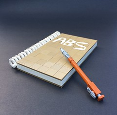Take Note (Tilde Brick) Tags: lego abs challenge book pen white tan dark orange black spiral letters text