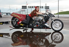 Holly_3517 (Fast an' Bulbous) Tags: dragbike bike motorcycle fast speed power drag strip race track pits nitro girl woman hot sexy model pinup long brunette hair high heels stilettos red shoes leather pvc leggings puddle reflection