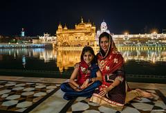 Amritsar night (Antoni Figueras) Tags: india punjab amritsar goldentemple motheranddaughter night reflections harmandirsahib