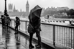 Umbrellalovers (markfly1) Tags: black white mono bandw bw monochromatic london england uk capital city two people kissing beneath umbrella classic shot tourists love grey mist fog rain storm weather bad big ben embankment 50mm lens nifty fifty street candid lovers d750 boats river thames railings shallow depth field raining misty