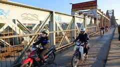 Motorcyclists - Long Bien Bridge (Vietnam) (ID Hearn Mackinnon) Tags: ha noi hanoi vietnam vietnamese viet 2016 motorcyclists motorcycles motorbike motorbikes bike motor idhearnmackinnon australian north people historic morning photographer city river