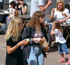 Girls snacking (Snapshooter46) Tags: girls snacking highstreet tring snapshot
