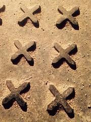 XX XX XX (emilyD98) Tags: photo macro detail rue city trottoir sol pattern croix cross lettres letters ville street tue plaque motif insolite