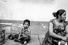 boy and mother on the street (Pejasar) Tags: 2015 guatemala college mission panajachel boy mother bw blackandwhite candid street child