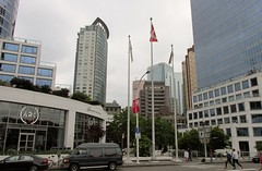 Downtown Vancouver, BC (Stabbur's Master) Tags: canada vancouver vancouverbc vancouverskyline vancouverskyscraper skyline skyscraper downtown downtownvancouver flag flagsflying flagonflagpole fairmontwaterfronthotel aubergevancouverhotel canadaplace