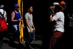 Only God Can Judge Me (Sergi_Escribano) Tags: barcelona barcelonastreetphotography streetsofbarcelona laboqueria mercatdesantjosep summer hat tourists boldcolors light pilgrim religion yellow dark city noircity shadows sergiescribanophotography