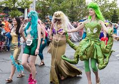 Three Mermaids and an Octopus (UrbanphotoZ) Tags: mermaidparade coneyislandmermaidparade women mermaids octopus greenwig bluewig whitewig leggings spandex gold beads scales shades spectators coneyisland brooklyn newyorkcity newyork nyc ny