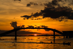 Bridge on Fire @Paraguat River, Corumbá Brazil (José Eduardo Nucci Photography) Tags: corumbá brazil bridge sunset boat landscape joséeduardonucci river water nature golden sky seasons tropical clouds nikon d800 landscapes southamerica