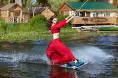 Woman riding a surfboard. (Kladyk_Petro) Tags: sport water wakeboarding extreme activity action lake lifestyles people wave wake surfing recreational splashing waterskiing adventure fitness wet sea athlete jumping surf skill exercising speed enjoyment up rope excitement nature hobbies ski flying motion boarding board adrenaline woman female surfboard danger risk courage wakeboard wakeboarder fun