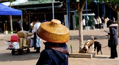 A touch of The Orient. (Bernard Spragg) Tags: asia hats bokeh hongkong orient bamboohats travel
