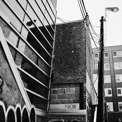 Les chaussures sont suspendus dehors... (woltarise) Tags: building chaussures réverbère reflets plywood ruelle montréal