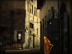 The bowels of the city (bdira3) Tags: night city woman yellow cape mysterious oriental textured old jaffo