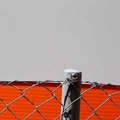 Gray, Black, Orange (zeh.hah.es.) Tags: kreis5 zurich zürich zaun fence zäune fences bauzaun construction constructionsite baustelle grid gitter simple minimal grau gray grey orange schwarz black schatten shadow schweiz switzerland hff