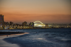 Moses Mabhida Stadium From The Pier, Durban (Paul Saad) Tags: durban nikon sunset sky clouds stadium outdoor pano panorama panoramic south africa mosesmabhidastadium longexposure lights sea beach waves