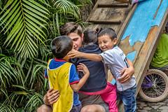 group hug on the slide (Pejasar) Tags: escuelaintegrada guatemala antigua boys phillip slide playground students