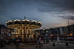 "spinning on the carousel (merry-go-round), calm summer evening in Honfleur, Normandy, France (grumpybaldprof) Tags: canon 70d ""canon70d"" ethereal impressionist impressionistic movement stillness colour colours summer evening gloaming tamron 16300 16300mm ""tamron16300mmf3563diiivcpzdb016"" honfleur normandy normandie france calvados ""vieuxbassin"" ""oldharbour"" ""quaistecatherine"" ""quaiquarantaine"" quai ""quaistetienne"" ""stecatherine"" ""lalieutenance"" quarantaine water boats sails ships harbour historic old ancient monument picturesque restaurants bars town port lights reflection architecture buildings mooring sailing stone collombage halftimbered yachts carousel merrygoround reflections ""waterreflections ""wetreflections""funfair ""eglisesaitecatherine"" contrast"
