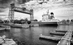 The Lift Bridge (maureen.elliott) Tags: blackandwhite ship boat water bridge liftbridge wellandcanal transportation greatlakes shipping port freighter