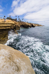 Infinity and Beyond (buddythunder) Tags: sandiego oceanbeach ob california usa 2017 travel wideangle people distant sunsetcliffs sandstone carving infinity pun wave splash layers figure