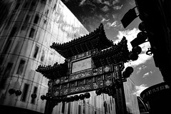 Chinatown London by Simon & His Camera (Simon & His Camera) Tags: london building bw blackandwhite chinatown architecture arch black city contrast glass iconic chinese lookingup monochrome outdoor passage simonandhiscamera sky urban vignette
