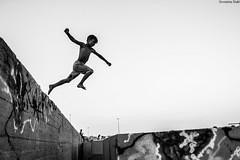jump (Georgina ♡) Tags: monochrome blackandwhite greece athens jump boy fun joy graffiti smile portrait people action streetphotography