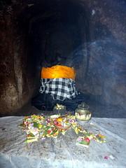 ubud_202 (OurTravelPics.com) Tags: ubud ganesha statue with offerings elephant cave goa gajah temple