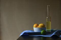 Lemonade (alideniese) Tags: stilllife table blue yellow green tablecloth lemons lime fruit citrus citrusfruit bottle lemonade light shadow colour white bowl