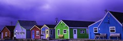 Colorful Village (Sonia Argenio Photography) Tags: fbsoniaargenio flickrsoniaargenio flickrbysoniaa green novascotia soniaargenio soniaargeniophotographer wood bench blue buildings burgundy business clouds cloudy daylight electricline electricpoles fishingvillage flickrsoniasgallery houses lilac purple red roof sidewalk stormy weather windows wine
