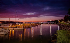 Sundown on the Breezeway (T P Mann Photography) Tags: reflecting reflections sundown sunset sun dusk small town rural breezeway dslr eos canon exposure long night lights light low seascape sea boats boat harbor marina lake charlevoix michigan jordan east