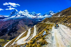 An amazing perspective of Huascarán mountain, the Portachuelo pass with Amanda on the road.