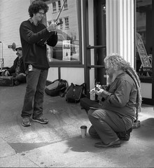 Street musicians Pike's Place (1 of 1) (sailronin) Tags: streetphotography analog film blackandwhite musicians people instruments fujiacros rolleiflex6008 hc110b seattle pikeplacemarket