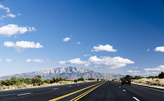 journeying (almostsummersky) Tags: horizon lines spring desert sandiamountains mountains jeep clouds road highway mountainrange car afternoon sky suv newmexico driving travel riorancho unitedstates us