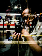 Abstract reflection (A. Yousuf Kurniawan) Tags: reflection abstract red selfie selfportrait train trainstation glass streetphotography colourstreetphotography cameraphone cameraphonestreet phonestreet contrast frankfurt closeup